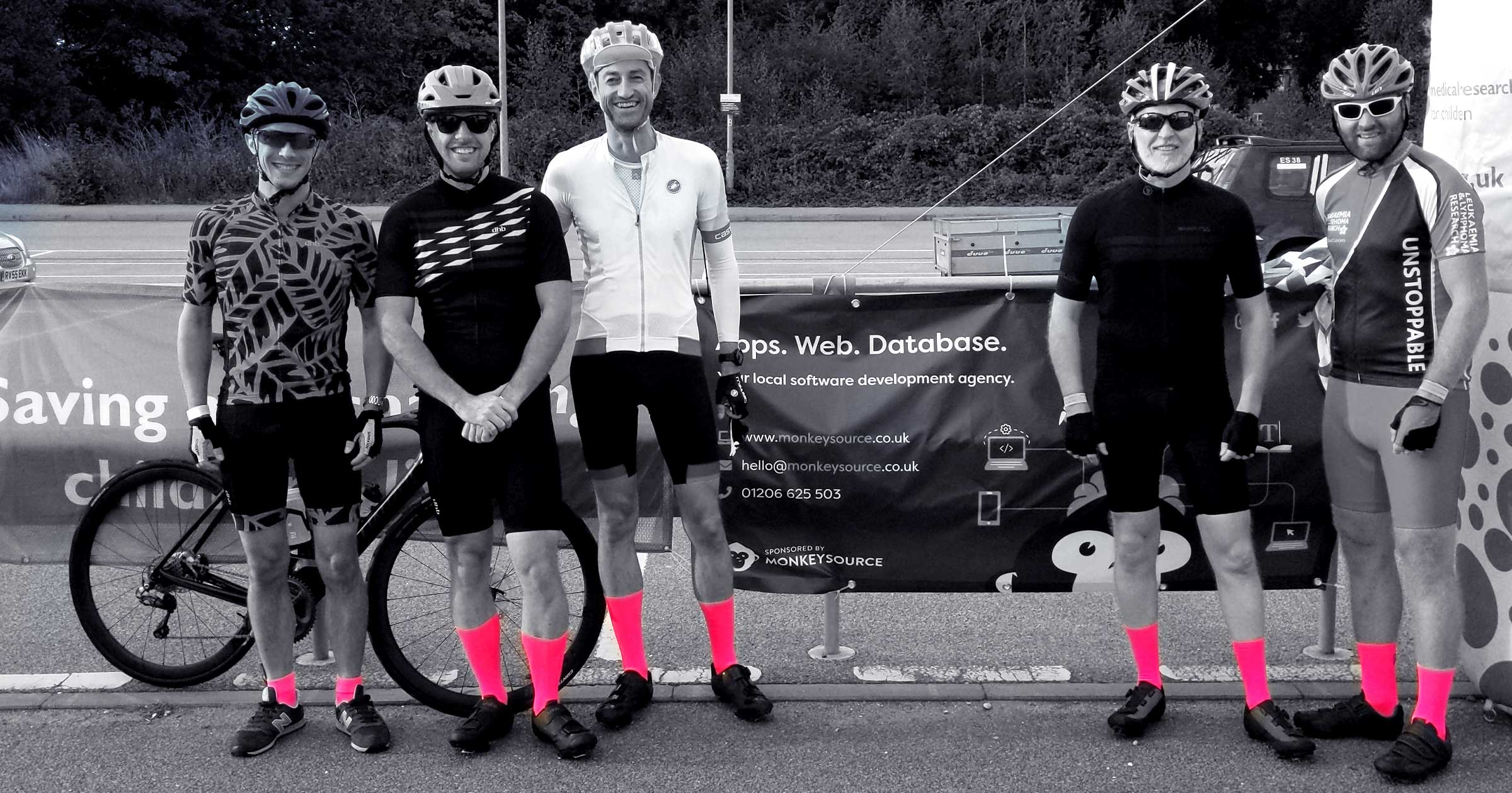An image showing the team before the race, wearing pink socks